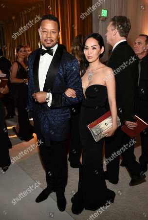 Terrence Howard, left, and Miranda Pak attend the Governors Ball after the Oscars, at the Dolby Theatre in Los Angeles