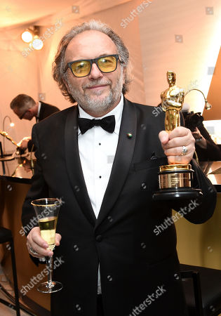 """Alessandro Bertolazzi poses with his award for best makeup and hairstyling for """"Suicide Squad"""" at the Governors Ball after the Oscars, at the Dolby Theatre in Los Angeles"""