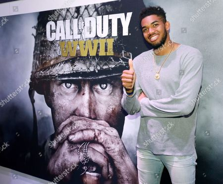 "Karl-Anthony Towns, sponsored by Activision, visits the ""Call of Duty: WWII"" booth during E3 2017 at the Los Angeles Convention Center, in Los Angeles, Calif"