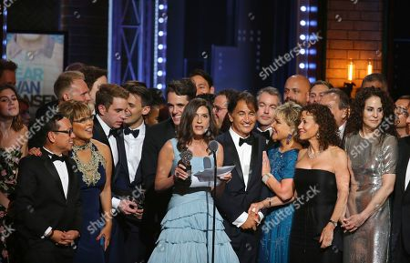 """Stacey Mindich, center, and the cast and crew of """"Dear Evan Hansen"""" accept the award for best musical at the 71st annual Tony Awards, in New York"""