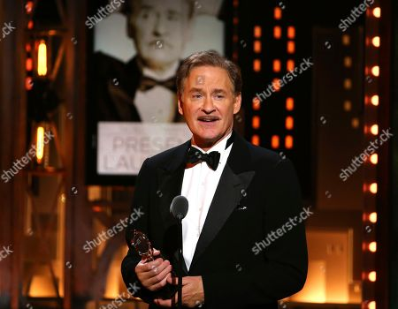 """Kevin Kline accepts the award for best performance by an actor in a leading role in a play for """"Present Laughter"""" at the 71st annual Tony Awards, in New York"""