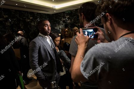 Actor Demetrius Shipp Jr talks to the media upon arrival at the screening of All Eyez On Me, the new Tupac Shakur biopic, at a central London hotel