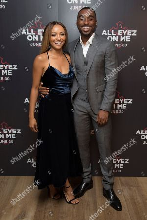 Actors Demetrius Shipp and Jr Kat Graham pose for photographers upon arrival at the screening of All Eyez On Me, the new Tupac Shakur biopic, at a central London hotel