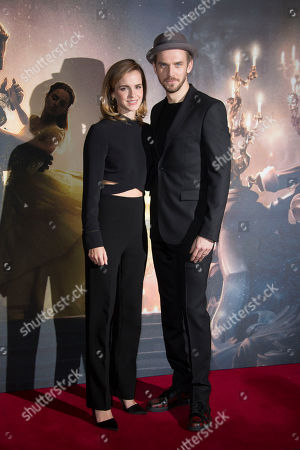 Actors from left, Emma Watson and Dan Stevens pose for photographers during a photo call for the Beauty And The Beast Premiere, in London