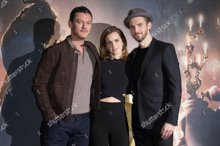 Actors from left, Luke Evans, Emma Watson and Dan Stevens pose for photographers during a photo call for the Beauty And The Beast Premiere, in London