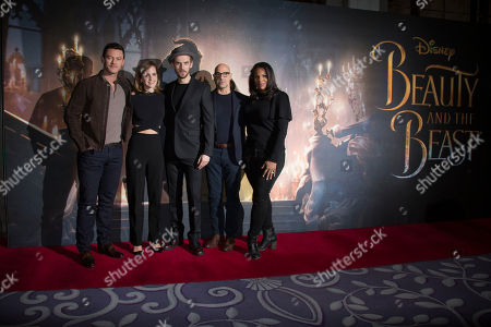 Actors from left, Luke Evans, Emma Watson, Dan Stevens, Stanley Tucci and Audra McDonald pose for photographers during a photo call for the Beauty And The Beast Premiere, in London