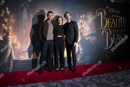 Actors from left, Luke Evans, Emma Watson and Dan Stevens pose for photographers during a photo call for the film Beauty And The Beast in London