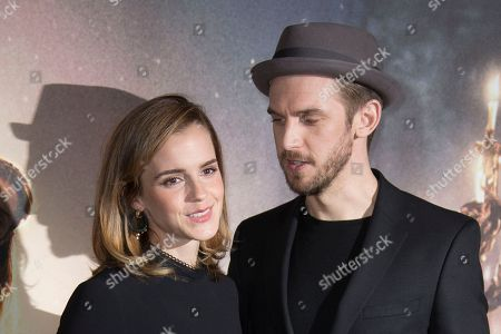 Actors Emma Watson. left, and Dan Stevens pose for photographers during a photo call for the Beauty And The Beast in London