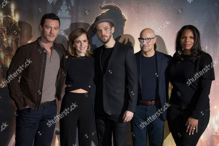 Actors from left, Luke Evans, Emma Watson, Dan Stevens, Stanley Tucci and Audra McDonald pose for photographers during a photo call for the film Beauty And The Beast in London