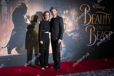 Actors from left, Emma Watson and Dan Stevens pose for photographers during a photo call for the film Beauty And The Beast in London