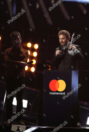 Duncan Jones, right, son of the late David Bowie, accepts the award for Album Of The Year on behalf of his father on stage at the Brit Awards 2017 in London