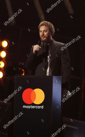 Duncan Jones, son of the late David Bowie, accepts the award for Album Of The Year on behalf of his father on stage at the Brit Awards 2017 in London