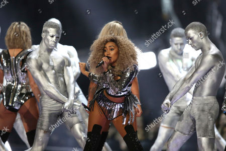 Singer Leigh-Ann Pinnock of the group Little Mix performs on stage at the Brit Awards 2017 in London
