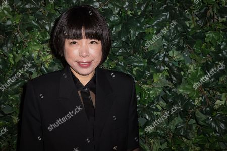 Angelica Cheung poses for photographers upon arrival at the Charles Finch and Chanel pre Bafta party in London