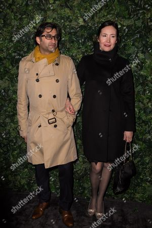 Asif Kapadia and Victoria Harwood pose for photographers upon arrival at the Charles Finch and Chanel pre Bafta party in London