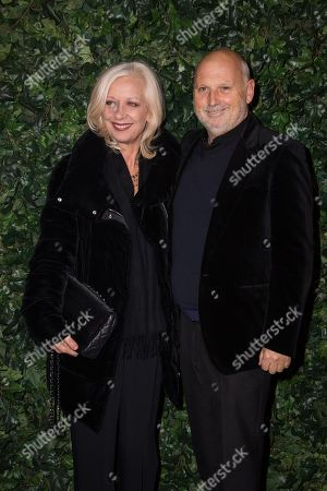 Mary Greenwell and Sam McKnight pose for photographers upon arrival at the Charles Finch and Chanel pre Bafta party in London