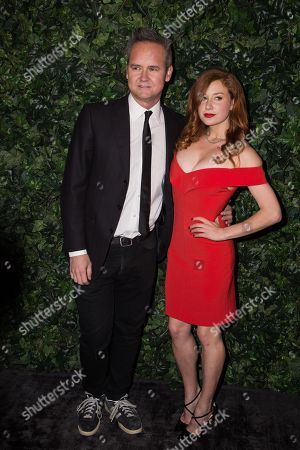 Roy Price and Lila Feinberg pose for photographers upon arrival at the Charles Finch and Chanel pre Bafta party in London