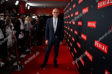 Stock Picture of Director Mick Jackson poses for photographers upon arrival at the Denial screening in central London