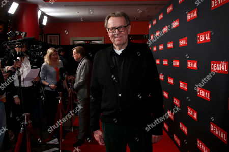 Actor Tom Wilkinson poses for photographers upon arrival at the Denial screening in central London