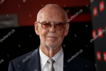 Director Mick Jackson poses for photographers upon arrival at the Denial screening in central London