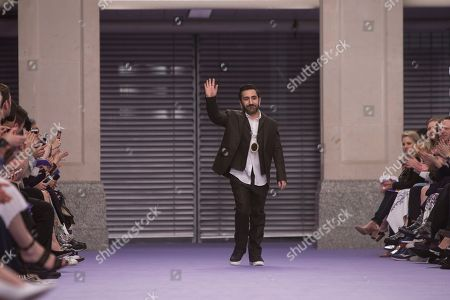 Mulberry Designer Johnny Coca waves following the Mulberry Autumn/Winter 2017 show, as part of London Fashion Week