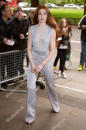 Singer Nicola Roberts poses for photographers upon arrival at the Ivor Novello Awards in central London