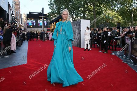 Poppy Delevigne poses for photographers upon arrival at the European premiere of the film 'King Arthur: Legend of the sword'' at a central London cinema