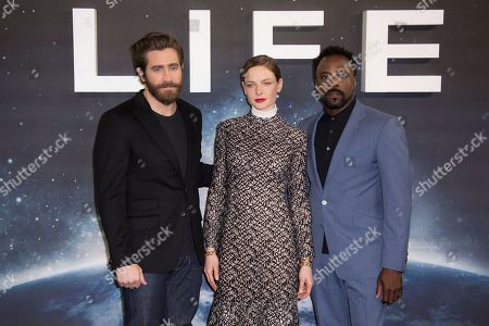 Actors from left, Jake Gyllenhall, Rebecca Ferguson and Ariyon Bakare pose for photographers at the photo call for the film, Life, at a central London hotel
