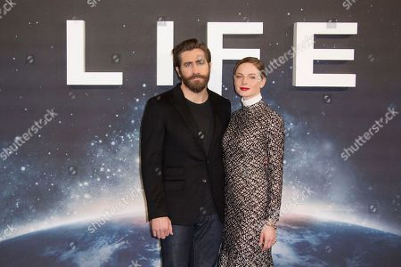 Actors from left, Jake Gyllenhall and Rebecca Ferguson pose for photographers at the photo call for the film, Life, at a central London hotel