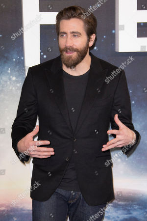 Stock Image of Actor Jake Gyllenhall poses for photographers at the photo call for the film, Life, at a central London hotel