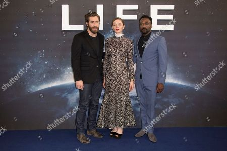 Stock Picture of Actors from left, Jake Gyllenhall, Rebecca Ferguson and Ariyon Bakare pose for photographers at the photo call for the film, Life, at a central London hotel