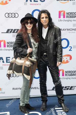 Alice Cooper and Sheryl Goddard pose for photographers upon arrival at the Silver Clef Awards, in London