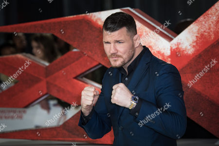 Mixed martial artists Michael Bisping poses for photographers upon arrival at the premiere of the film 'xXx: Return of Xander Cage', in London