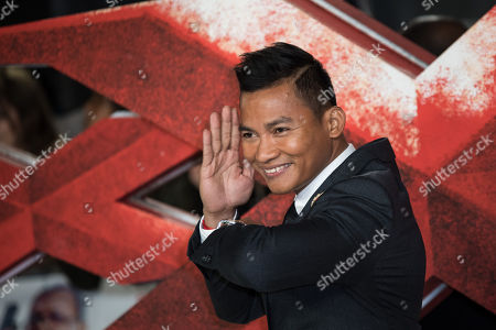 Actor Tony Jaa poses for photographers upon arrival at the premiere of the film 'xXx: Return of Xander Cage', in London