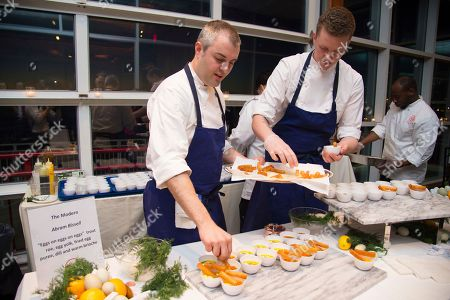 Chef Abram Bissell, left, is seen at the Careers Through Culinary Arts Program (C-CAP) benefit grand tasting event at Pier Sixty, in New York