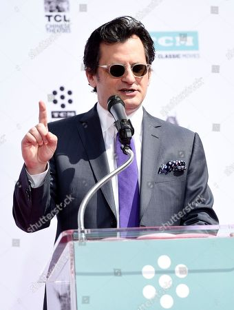 TCM host Ben Mankiewicz addresses the crowd during a hand and footprint ceremony for Rob and Carl Reiner at the TCL Chinese Theatre, in Los Angeles