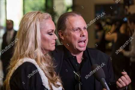 Catherine Hickland, left, and Todd Fisher arrive at the Carrie Fisher and Debbie Reynolds Memorial Service at The Forest Lawn, in Los Angeles
