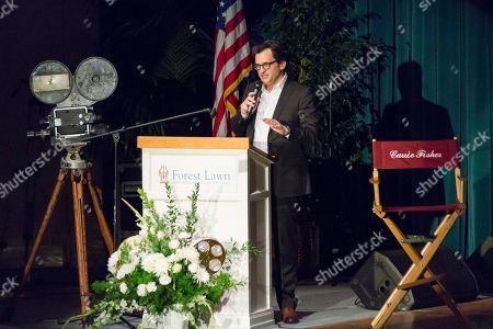 Ben Mankiewicz speaks at the Carrie Fisher and Debbie Reynolds Memorial Service at The Forest Lawn, in Los Angeles. Laughter, music and the tapping of dancing shoes reverberated throughout a public memorial to Reynolds and Fisher, which loved ones say is just how the actresses would have wanted it