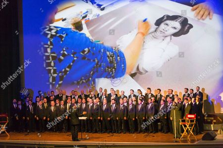 The Gay Men's Chorus of Los Angeles performs at the Carrie Fisher and Debbie Reynolds Memorial Service at The Forest Lawn, in Los Angeles
