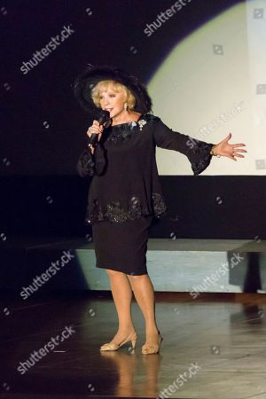 Ruta Lee performs at the Carrie Fisher and Debbie Reynolds Memorial Service at The Forest Lawn, in Los Angeles