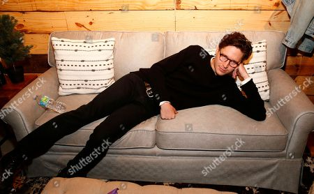 """Come Swim"""" actor Josh Kaye lounges on a couch in the Indiewire Photo Studio at Chase Sapphire on Main, during the 2017 Sundance Film Festival, in Park City, Utah"""