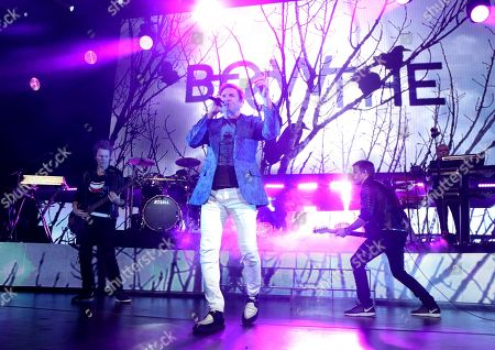 Stock Picture of John Taylor, from left, Simon Le Bon, Nick Rhodes and Dom Brown of the band Duran Duran perform in concert at The Theater at MGM National Harbor, in Oxon Hill, MD