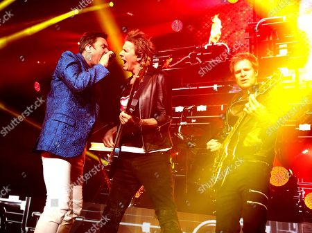 Stock Photo of John Taylor, from left, Simon Le Bon and Dom Brown of the band Duran Duran perform in concert at The Theater at MGM National Harbor, in Oxon Hill, MD