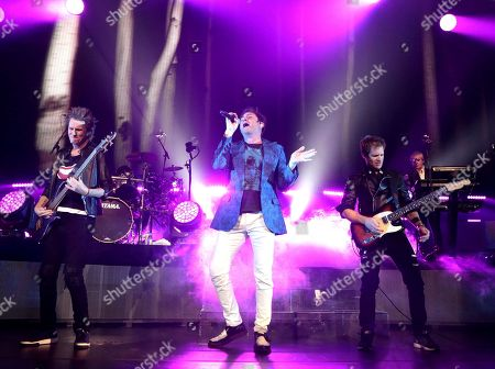 John Taylor, from left, Simon Le Bon and Dom Brown of the band Duran Duran perform in concert at The Theater at MGM National Harbor, in Oxon Hill, MD