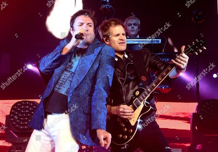 Simon Le Bon, left, and Dom Brown of the band Duran Duran perform in concert at The Theater at MGM National Harbor, in Oxon Hill, MD