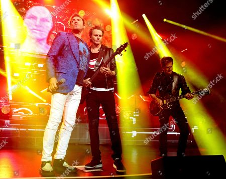 Simon Le Bon, from left, John Taylor and Dom Brown of the band Duran Duran perform in concert at The Theater at MGM National Harbor, in Oxon Hill, MD