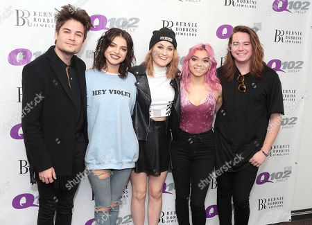 Iain Shipp, from left, Nia Lovelis, Miranda Miller, Rena Lovelis and Casey Moreta of the band Hey Violet visit the Q102 Performance Theater, in Philadelphia