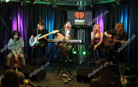 Nia Lovelis, from left, Iain Shipp, Miranda Miller, Rena Lovelis and Casey Moreta of the band Hey Violet visit the Q102 Performance Theater, in Philadelphia