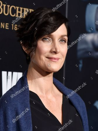 """Actress Carrie-Ann Moss poses at the premiere of the film """"John Wick: Chapter 2,"""" at ArcLight Cinemas, in Los Angeles"""