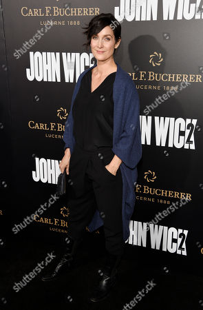 """Stock Photo of Actress Carrie-Ann Moss poses at the premiere of the film """"John Wick: Chapter 2,"""" at ArcLight Cinemas, in Los Angeles"""